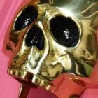 Close up of Polished Brass Skeleton Door knocker