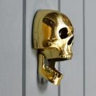 Side view of jaw on skull door knocker