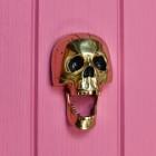Polished brass novelty spooky skull door knocker