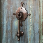 Antique Copper Door Knocker on Wooden door