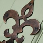 Close up of French Fleur de lys symbol door knocker