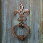 Antique Copper Door Knocker on old wooden door