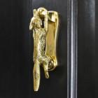 Polished Brass Running Fox Door knocker on black wood door