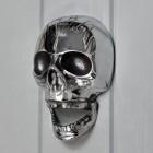 Bright Chrome Skull door knocker on grey door