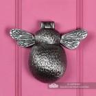 Antique Pewter Bumblebee Door Knocker on a Pink Door