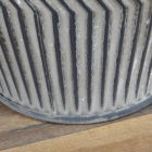 Close-up of the Base of the Vintage Metal Dolly Tub Set