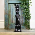 Side view of novelty black cast begging dog door porter