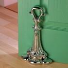 Bright Chrome Coalbrookdale Door Porter holding green door