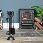 """Duchess"" Iron Fireside Companion Set Next to the Fireplace"