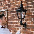 Exterior wall light mounted on brick wall