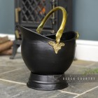 Black & Brass Traditional Coal Bucket in Situ Next to the Fireplace