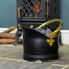 Black Iron and Polished Brass Traditional Coal Bucket Holding Coal by the Fireplace