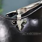 Close-up of the Nickel Fleur De Lys Design on the Side