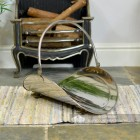 """Evington"" Stainless Steel Curved Log Basket by a Wood Fire"