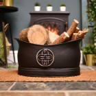 Log and coal bucket in living room infront of log burner