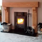 Blacksmith Knot Iron Companion Set next to log burner