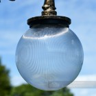 Fluted Globe Luminaire with gold ornate lamp post