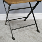 Close-up of the Metal Legs on the Chair