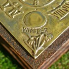 Four Seasons garden sundial close up of cast winter detail
