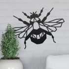 Geometric Iron Bumblebee Wall Art on a Grey Wall