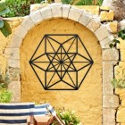 Geometric Cuboctahedron Wall Art in Situ Outside on a Yellow Wall