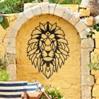 Geometric Lion Steel Wall Art in a Display in the Garden on a Yellow Wall