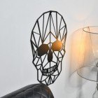 Side profile of geometric skull on wall