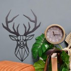 Geometric Stag Steel Wall Art in Situ Next to a Floor Standing Clock