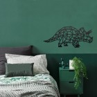 Geometric Iron Triceratops Wall Art in Situ in a Bedroom