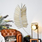 Golden Palm Leaf Wall Art in Situ on a White Wall