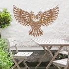 """Great Horned Owl"" Wall Art in Use Above a Wooden Table & Chair Set"