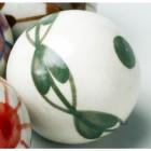 Racing Green handpainted ceramic ball close up