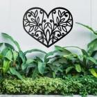 Flower Foliage Heart Wall Art above a Bush in the Garden