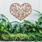 Flower Foliage Heart Wall Art above a Bush in the Garden