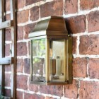 """Heathfield"" Antique Brass Half Wall Lantern in Situ on a Brick Wall"