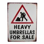 "White ""Heavy Umbrellas For Sale"" Sign"