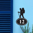 Hiking Iron House Number Sign in Situ on a Blue Wall