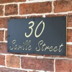 "Cream ""Saville"" House Sign in Situ on the Wall"