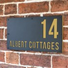"Sand Yellow ""Albert"" House Sign in Situ on the Wall"