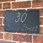 "Light Grey ""Saville"" House Sign in Situ on the Wall"