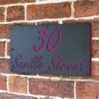 """Purple """"Saville"""" House Sign in Situ on the Wall"""