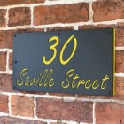 """Zinc Yellow """"Saville"""" House Sign in Situ on the Wall"""