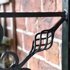 Close up of twisted basket on bracket