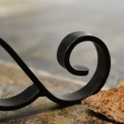 Traditional blacksmith curl on welly rack foot