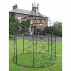 Black Gazebo in front of town house with support bars