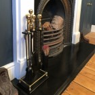 Iron Companion set with polished brass handles by fire