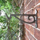 Side View of the Iron Hanging Basket Bracket Mounted to a Brick Wall