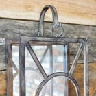View of the bracket holding the iron candle holder