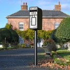 King George Rex Black Period Post Box in Situ in the Front Garden