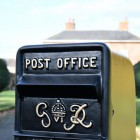 Close-up of the Gold Wording on the King George Rex Black Period Post Box